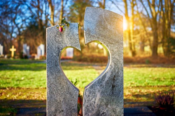 Tombstone with heart on graveyard